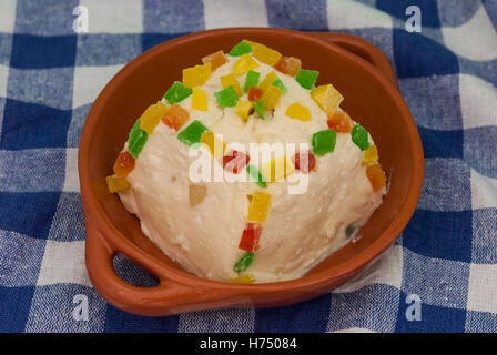 Traditional Russian cottage cheese dessert (paskha) with candied fruits on the checkered tablecloth closeup. - Stock Photo