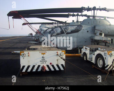 27th January 2003  Flight Deck Tractors and Super Cobra helicopters on the flight deck of the USS Nassau in the - Stock Photo