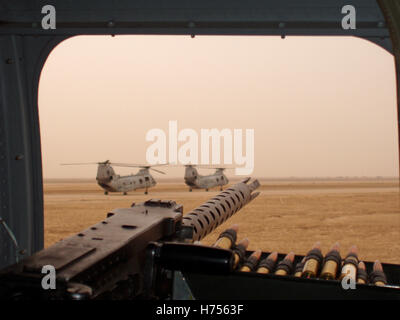 19th October 2003 A heavy machine-gun mounted on a CH-46E Sea Knight helicopter, taxiing for take-off with other Sea Knights at Basra Airport. Stock Photo