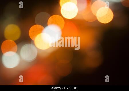 City lights big abstract circular bokeh on orange background. - Stock Photo