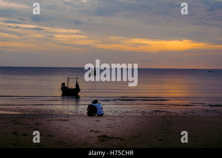 Couple hugging on the beach on sunrise in Prachuap Khiri Khan Province, Southern of Thailand. - Stock Photo
