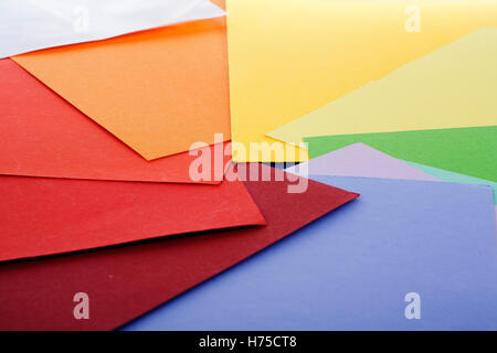 Paper cardboard. Colorful papers. Paper texture with red orange yellow green blue purple colors. Papers in background. - Stock Photo