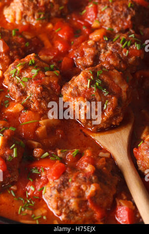 Albondigas Meatballs in sauce macro. vertical background - Stock Photo