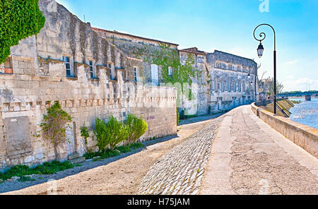 The embankment of arles with the ruins of medieval house. - Stock Photo