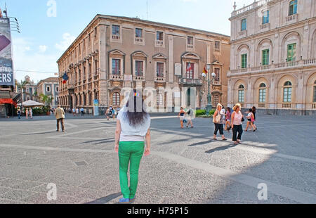 The tourists walk in University Square and enjoy the historic mansions and main city landmarks - Stock Photo