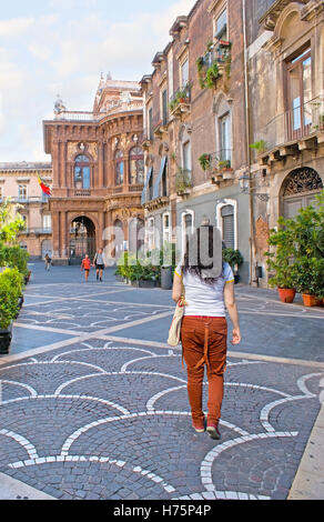 The street in the old town with the scenic mansions, patterns of the paving stone and side view on Massimo Bellini - Stock Photo