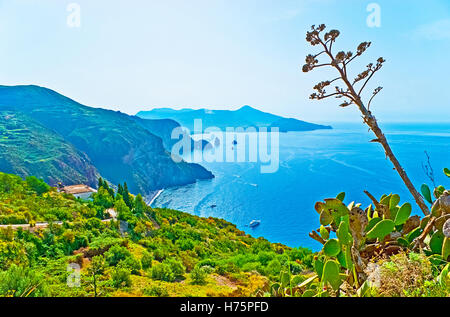 The view on the smoking crater of Volcano Island from the top of Lipari mountains, Aeolian Islands, Italy. - Stock Photo