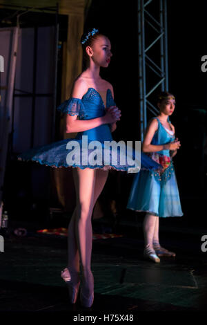 A young ballerina is preparing to go on the stage during the All-Russian ballet competition in Moscow, Russia - Stock Photo