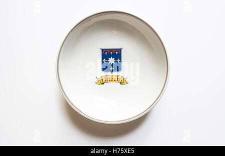 A dipping dish with the i Ricchi logo of a high-end Tuscan restaurant in Washington, DC - Stock Photo