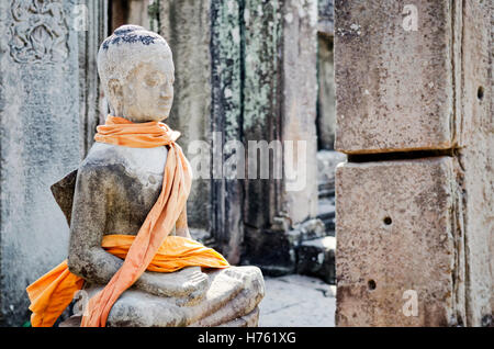 cambodian ancient buddha statue in famous landmark angkor wat temple siem reap cambodia - Stock Photo