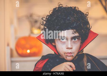 Portrait of a boy wearing a halloween dracula costume - Stock Photo