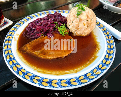 Bavarian Sauerbraten of beef with red cabbage and bread dumplings - Stock Photo