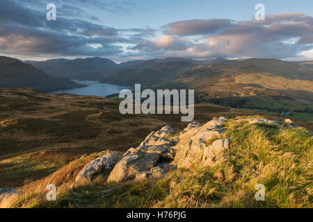 View towards Ullswater from Gowbarrow Fell in dramatic autumn morning light, English Lake District national park, - Stock Photo