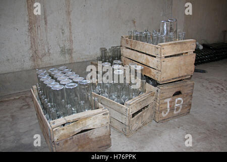 Empty bottles in wooden boxes, ready to be filled, Camargo, Bolivia - Stock Photo