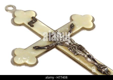 Pearly crucifix isolated on white background - Stock Photo