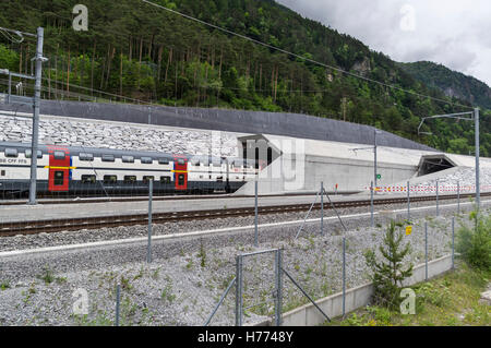 SBB IC 2000 double decker train enters the 57 km long Gotthard base tunnel at the north portal in Erstfeld, Switzerland. - Stock Photo