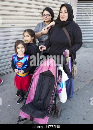 Palestinian family celebrates Halloween in the Bensonhurst section of Brooklyn, New York, 2016. - Stock Photo