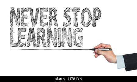 never stop learning written by hand, hand writing on transparent board, photo - Stock Photo