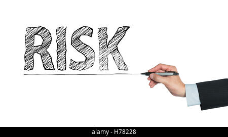 risk written by hand, hand writing on transparent board, photo - Stock Photo