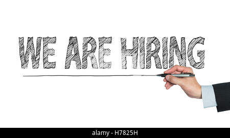 we are hiring written by hand, hand writing on transparent board, photo - Stock Photo