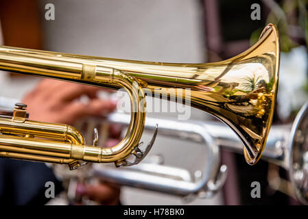 Musical performer at the cinco de Mayo celebration in Mexico singing to celebrate the holiday fiesta. Mariachi cantando - Stock Photo