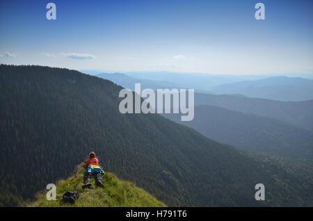 Female photographers on a mountain peak shooting the landscape - Stock Photo