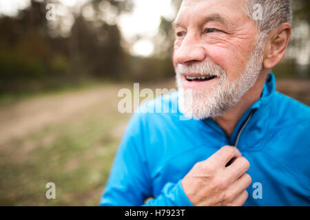 Senior runner in nature. Man resting, smiling. Close up. - Stock Photo
