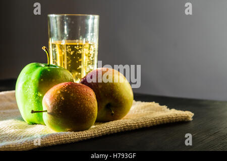 Fresh apples and apple wine drink in beautiful sunshine - Stock Photo
