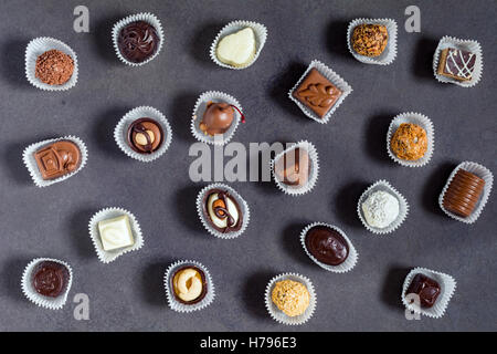 Assortment of chocolate pralines, candies and bonbons. Top view - Stock Photo