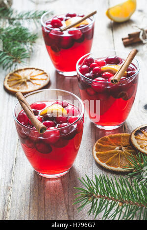 Mulled wine with cranberries and spices. Christmas or New Year drink - Stock Photo