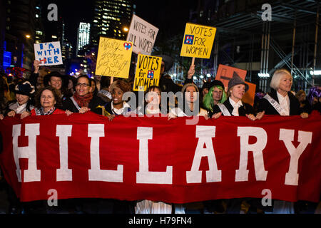 New York, NY - 31 October 2016. Marchers in support of Hillary Clinton marrch behind a banner that simply reads - Stock Photo
