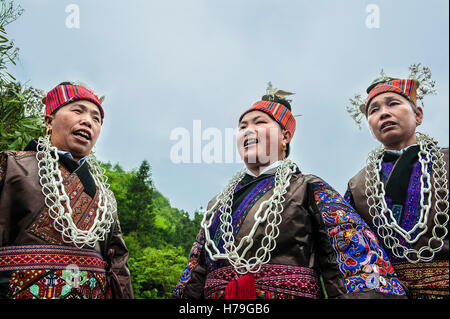 Miao women in typical dresses sing during the beginning of the Sister's Meal Festival in Shidong village, in Guizhou - Stock Photo
