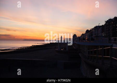Striking sunset over the sea, Hastings, East Sussex, UK - Stock Photo