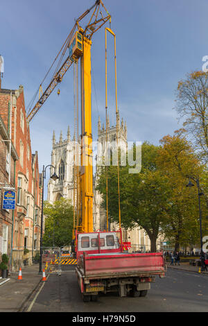 A huge crane in front of York Minster during nearby construction work - Stock Photo