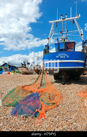 Hastings fishing boat Bethan Louise with colourful nets spread out to dry on the Old Town Stade fishermen's beach, - Stock Photo