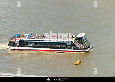 London Southbank Tate Modern Alpha City Cruise boat ship on River Thames with tourists - Stock Photo