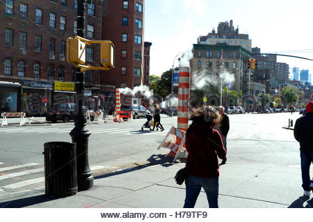 Street scene on 7th Avenue South (Greenwich Village), showing the steam funnel vents. Manhattan, New York, USA. - Stock Photo