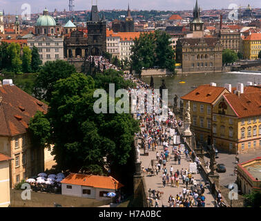 Tourists on Charles Bridge, Prague, Czech Republic. - Stock Photo