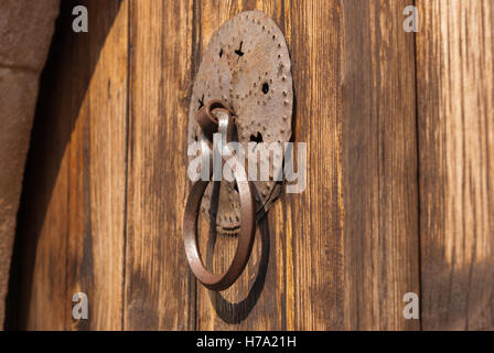 Paris, France; Old Rusted Brown Door Knocker On A Shabby Blue Door Closeup.  Phikardou (Fikardou)