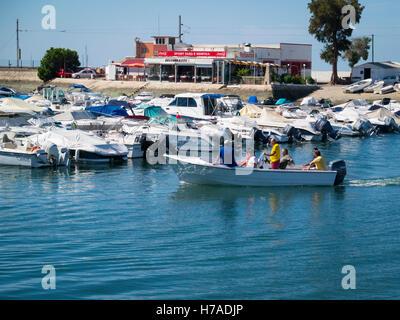 Portugal Algarve 4th c BC ancient old city port Faro marina pleasure leisure power boats outboard motor motors people - Stock Photo