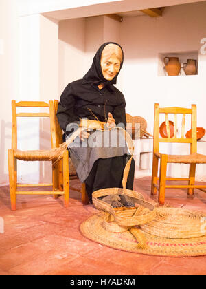 Portugal Algarve 4th c BC ancient old city port Faro Museu Regional do Algarve museum peasant figure basket weaving - Stock Photo