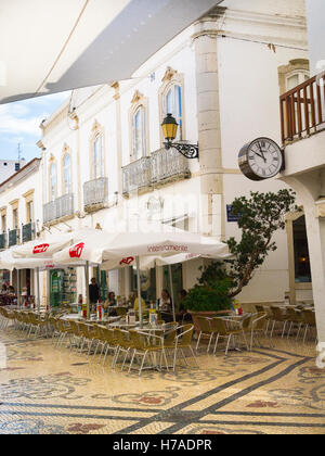 Portugal Algarve 4th c BC ancient old city port Faro typical mosaic street road roadside cafe restaurant open air - Stock Photo
