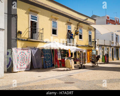 Portugal 4th c BC ancient old city port Faro typical mosaic road with tourist shop store Algarve Hostel bedspread - Stock Photo