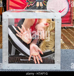 Pleasureland, Southport, Merseyside UK. Female contortionist performs during Spook-Fest half-term Halloween week - Stock Photo
