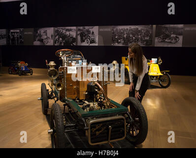 London,UK,3rd November 2016,A lady admires a 1903  De DION-BOUTON  5hp on display during Press Day ahead of the - Stock Photo