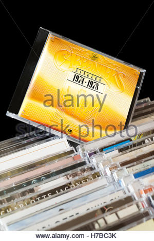 The Carpenters Singles 1974-1978 CD pulled out from among rows of other CD's - Stock Photo