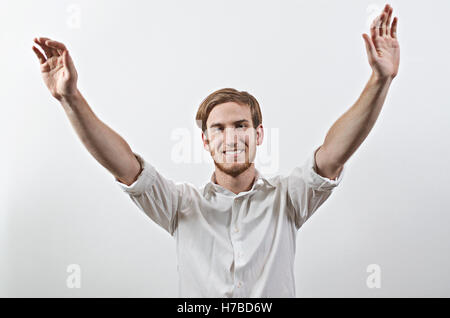 Smiling Joyful, Very Happy Young Man in White Shirt, Arms Raised - Stock Photo