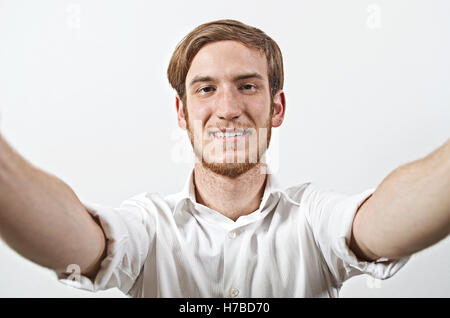 Young Adult Man Takes a Selfie - Stock Photo