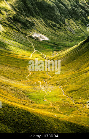 A beautiful view on a small serpentine road in Carpathian mountains - Stock Photo