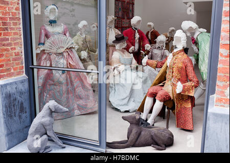 Room of wire models in historical replica paper garments at leisure, by Isabelle de Borchgrave - Stock Photo